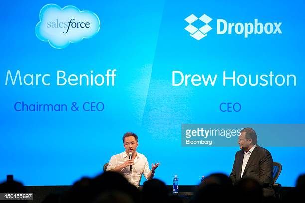 Drew Houston chief executive officer and cofounder of Dropbox Inc left speaks as Marc Benioff chairman and chief executive officer of Salesforcecom...