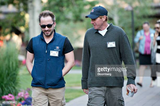 Drew Houston chief executive officer and cofounder of Dropbox Inc left and Eric Eisner founder and chief executive officer of Double E Pictures walk...