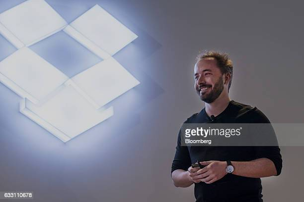 Drew Houston chief executive officer and cofounder of Dropbox Inc smiles while speaking during an event in San Francisco California US on Monday Jan...