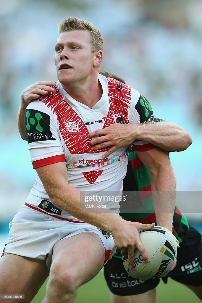 Drew Hutchison of the Dragons is tackled as he looks to pass during the NRL Charity Shield match between the St George Illawarra Dragons and the South Sydney Rabbitohs at ANZ Stadium on February 13, 2016 in Sydney, Australia.