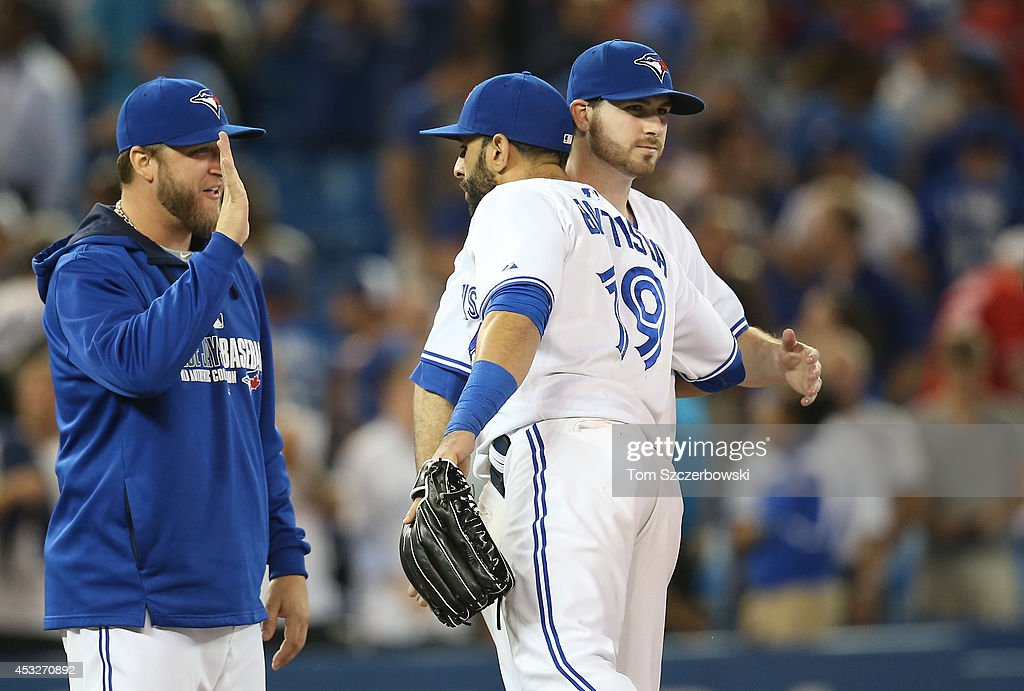 <a gi-track='captionPersonalityLinkClicked' href=/galleries/search?phrase=Drew+Hutchison&family=editorial&specificpeople=8048810 ng-click='$event.stopPropagation()'>Drew Hutchison</a> #36 of the Toronto Blue Jays is congratulated by Jose Bautista #19 after their victory during MLB game action against the Baltimore Orioles on August 6, 2014 at Rogers Centre in Toronto, Ontario, Canada.