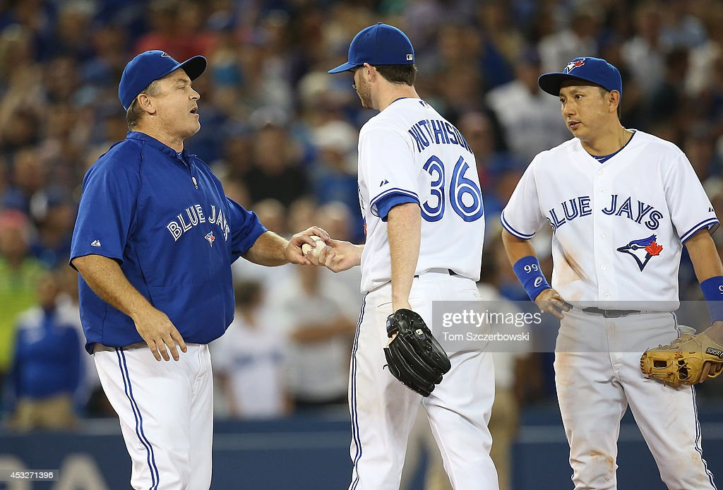 <a gi-track='captionPersonalityLinkClicked' href=/galleries/search?phrase=Drew+Hutchison&family=editorial&specificpeople=8048810 ng-click='$event.stopPropagation()'>Drew Hutchison</a> #36 of the Toronto Blue Jays is relieved by manager <a gi-track='captionPersonalityLinkClicked' href=/galleries/search?phrase=John+Gibbons&family=editorial&specificpeople=218120 ng-click='$event.stopPropagation()'>John Gibbons</a> #5 as <a gi-track='captionPersonalityLinkClicked' href=/galleries/search?phrase=Munenori+Kawasaki&family=editorial&specificpeople=690355 ng-click='$event.stopPropagation()'>Munenori Kawasaki</a> #66 looks on in the ninth inning during MLB game action against the Baltimore Orioles on August 6, 2014 at Rogers Centre in Toronto, Ontario, Canada.