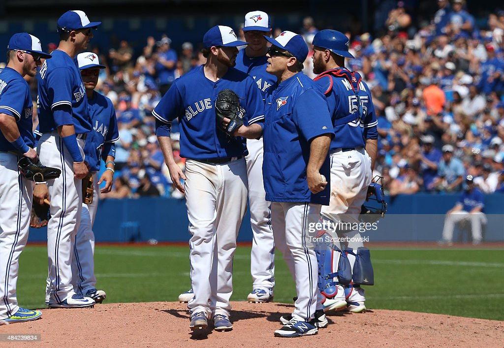 Drew Hutchison #36 of the Toronto Blue Jays is relieved by manager John Gibbons #5 in the seventh inning during MLB game action against the New York Yankees on August 16, 2015 at Rogers Centre in Toronto, Ontario, Canada.