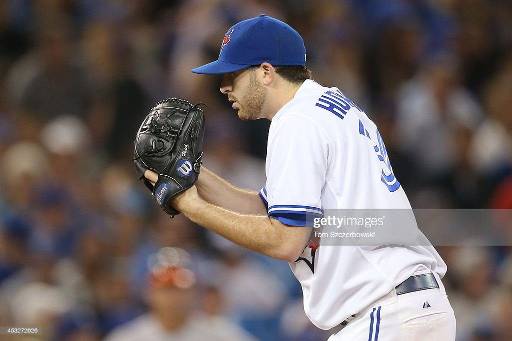 <a gi-track='captionPersonalityLinkClicked' href=/galleries/search?phrase=Drew+Hutchison&family=editorial&specificpeople=8048810 ng-click='$event.stopPropagation()'>Drew Hutchison</a> #36 of the Toronto Blue Jays looks in before delivering a pitch in the ninth inning during MLB game action against the Baltimore Orioles on August 6, 2014 at Rogers Centre in Toronto, Ontario, Canada.