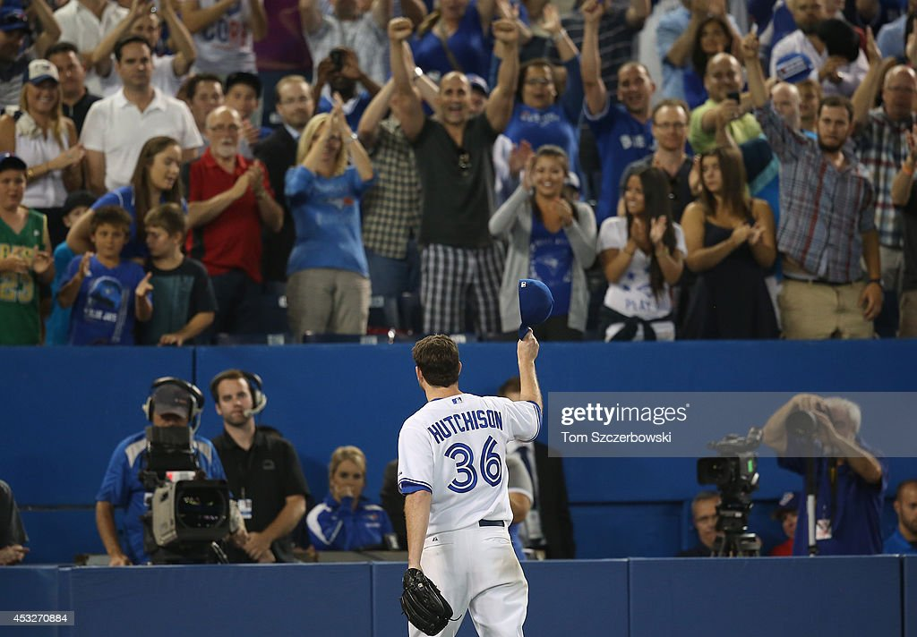 <a gi-track='captionPersonalityLinkClicked' href=/galleries/search?phrase=Drew+Hutchison&family=editorial&specificpeople=8048810 ng-click='$event.stopPropagation()'>Drew Hutchison</a> #36 of the Toronto Blue Jays salutes the fans as he exits the game with two outs in the ninth inning during MLB game action against the Baltimore Orioles on August 6, 2014 at Rogers Centre in Toronto, Ontario, Canada.