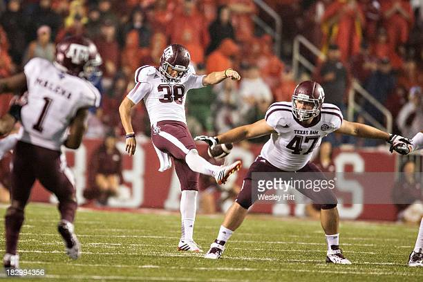 Drew Kaser of the Texas AM Aggies punts the ball against the Arkansas Razorbacks at Razorback Stadium on September 28 2013 in Fayetteville Arkansas...