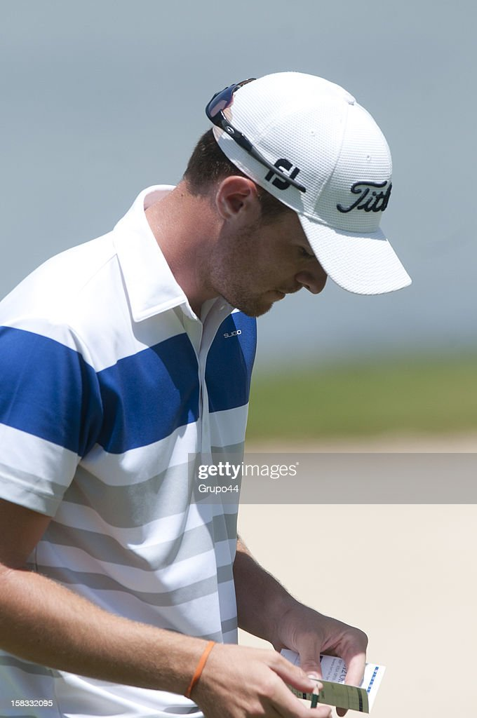 Drew Kittleson of USA checks his card during the opening day of the 107 Visa Golf Open presented by Peugeot as part of the PGA Latin America at Nordelta Golf Club on December 13, 2012 in Buenos Aires, Argentina.