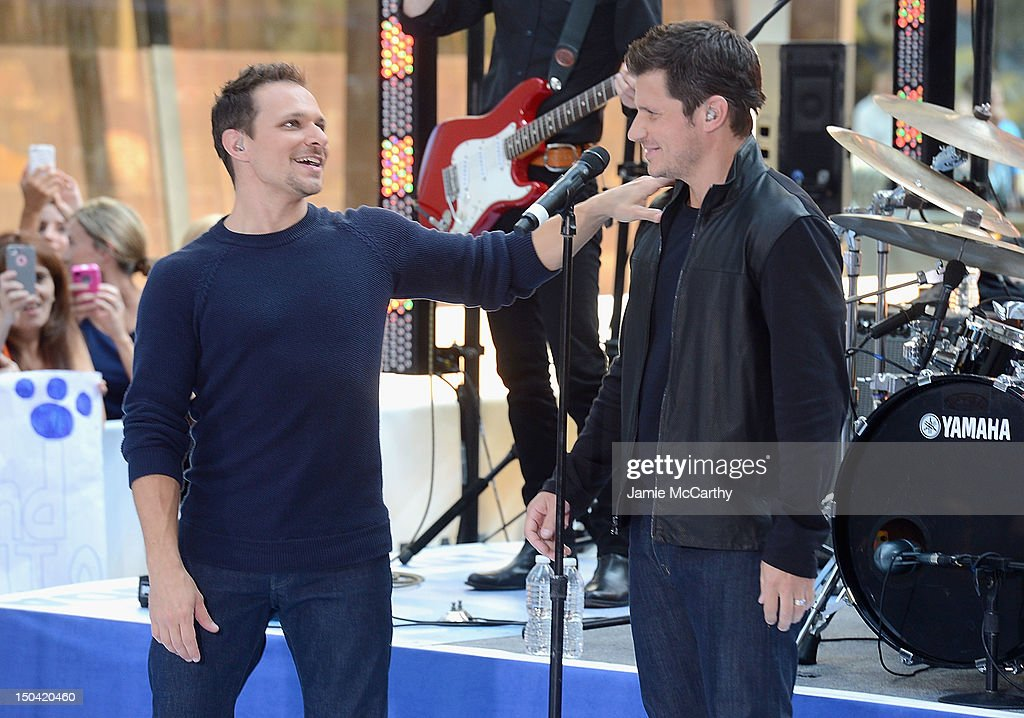 Drew Lachey and Nick Lachey of 98 Degrees perform on NBC's 'Today' at Rockefeller Plaza on August 17 2012 in New York City
