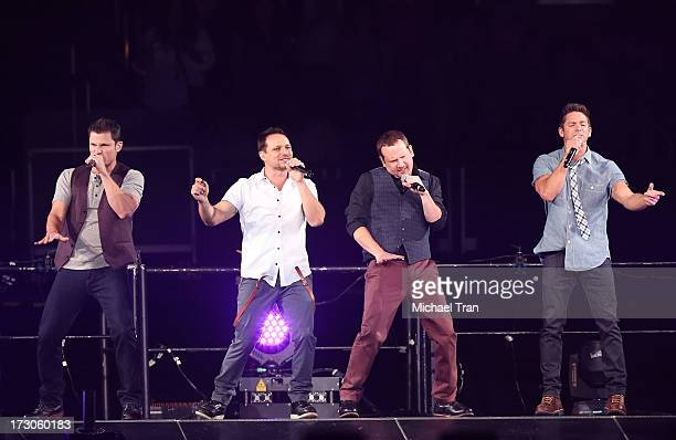 Drew Lachey Jeff Timmons Nick Lachey Justin Jeffre of 98 Degrees performs onstage during 'The Package Tour' held at Staples Center on July 5 2013 in...
