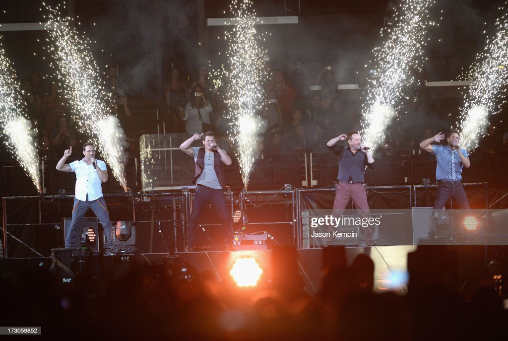 Drew Lachey Nick Lachey Justin Jeffre and Jeff Timmons of the band 98 Degrees perform at Staples Center on July 5 2013 in Los Angeles California