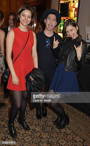 Drew Lam poses with Anna Kuprienko and Sonia Kuprienko of The Bloom Twins as Charles Finch Efe Cakarel Hikari Yokoyama celebrate new film platform...
