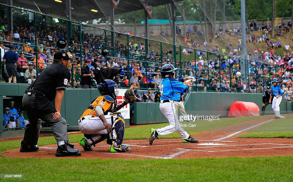 Drew Laspaluto #4 of of the West Team from Las Vegas, Nevada follows his three run RBI double against the Great Lakes Team from Chicago, Illinois during the first inning of the United States Championship game of the Little League World Series at Lamade Stadium on August 23, 2014 in South Williamsport, Pennsylvania.