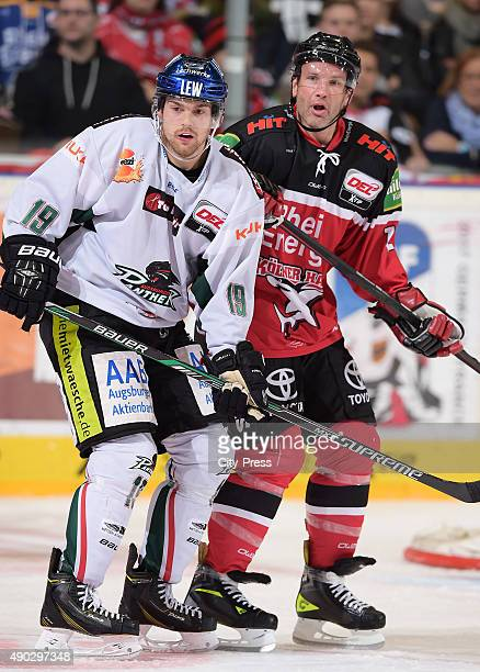 Drew LeBlanc of the Augsburger Panther and Mirko Luedemann of the Koelner Haie during the DEL game between Koelner Haie and the Augsburger Panther on...