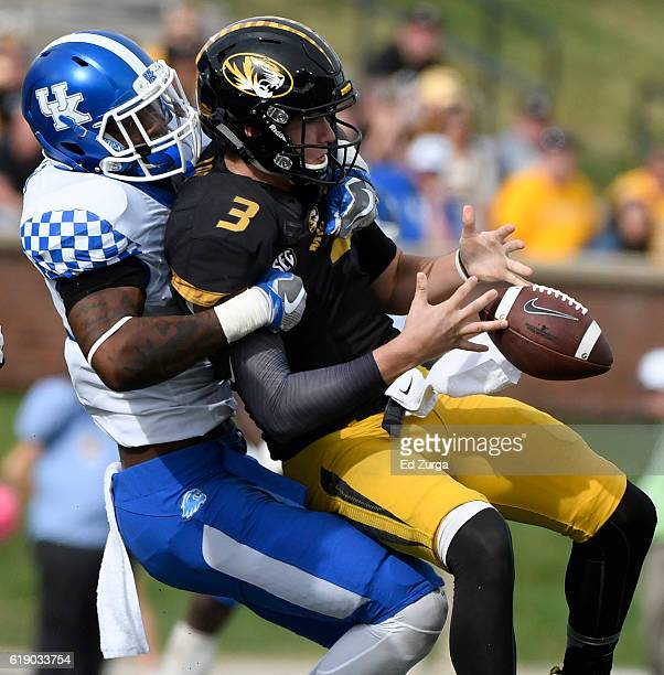 Drew Lock of the Missouri Tigers fumbles the ball as he is hit by Josh Allen of the Kentucky Wildcats in the fourth quarter at Memorial Stadium on...