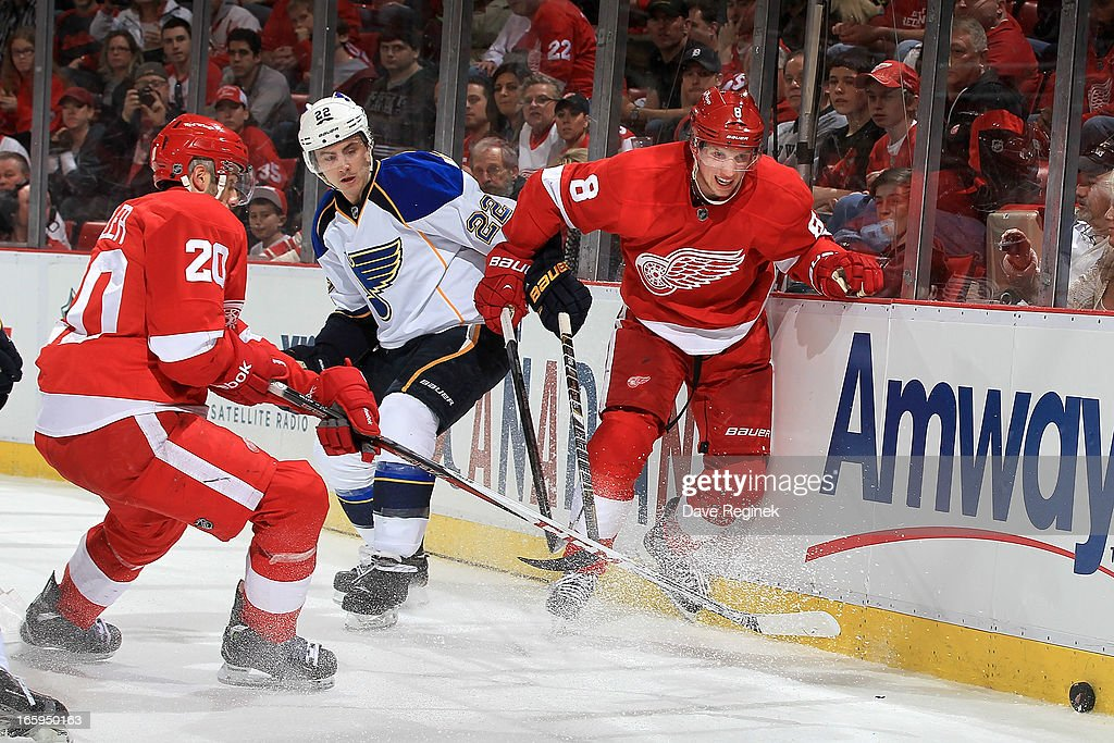 Drew Miller #20 and <a gi-track='captionPersonalityLinkClicked' href=/galleries/search?phrase=Justin+Abdelkader&family=editorial&specificpeople=2271858 ng-click='$event.stopPropagation()'>Justin Abdelkader</a> #8 of the Detroit Red Wings battle for the puck along the boards wit <a gi-track='captionPersonalityLinkClicked' href=/galleries/search?phrase=Kevin+Shattenkirk&family=editorial&specificpeople=4324986 ng-click='$event.stopPropagation()'>Kevin Shattenkirk</a> #22 of the St. Louis Blues during a NHL game at Joe Louis Arena on April 7, 2013 in Detroit, Michigan.