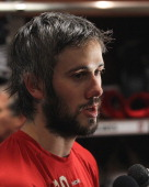 Drew Miller of the Detroit Red Wings adresses media after Game Six of the Western Conference Semifinals of the 2011 NHL Stanley Cup Playoffs against...