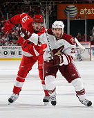 Drew Miller of the Detroit Red Wings and Lee Stempniak of the Phoenix Coyotes skate to the puck during Game Six of the Western Stanley Cup Playoffs...
