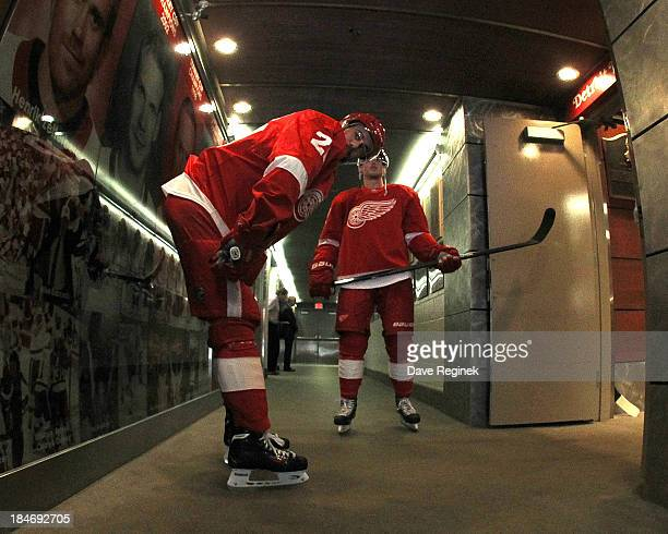 Drew Miller of the Detroit Red Wings and teammate Cory Emmerton stand in the cooridor before warmups prior to a NHL game against the Phoenix Coyotes...