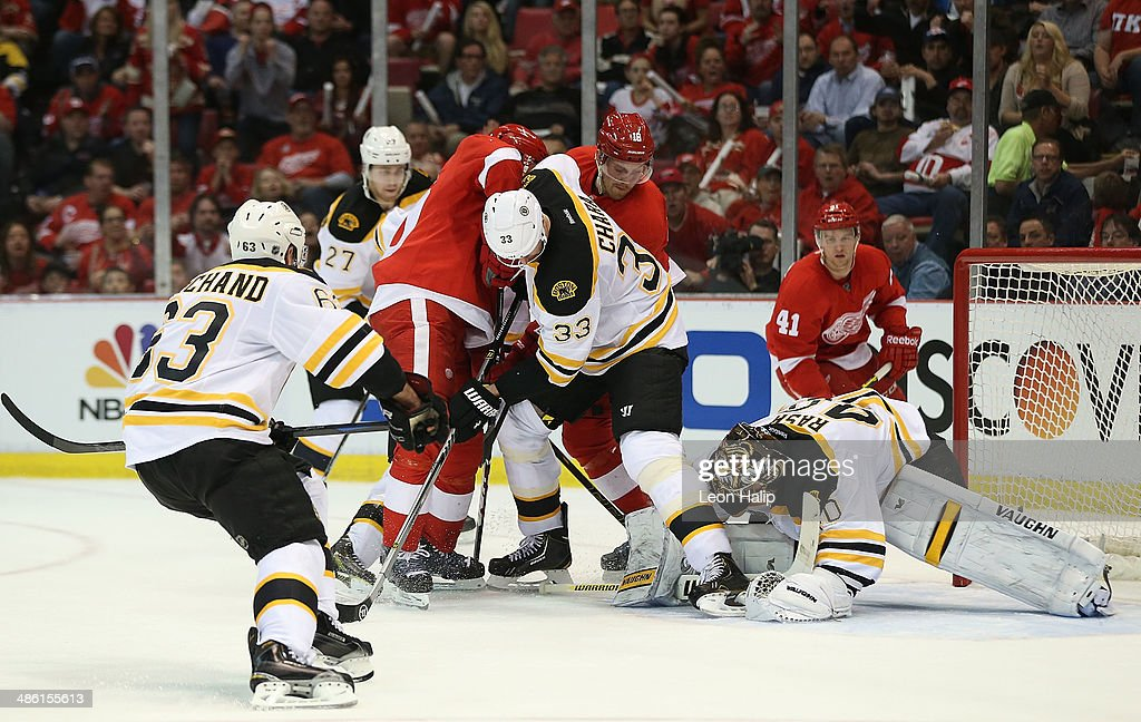 Drew Miller #20 of the Detroit Red Wings and Zdeno Chara #33 of the Boston Bruins battle in front of Bruins goalie Tuukka Rask #40 during the second period of Game Three of the First Round of the 2014 NHL Stanley Cup Playoffs at Joe Louis Arena on April 22, 2014 in Detroit, Michigan.