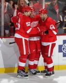 Drew Miller of the Detroit Red Wings celebrates his goal with teammates Todd Bertuzzi and Jonathan Ericsson during an NHL game against the Winnipeg...