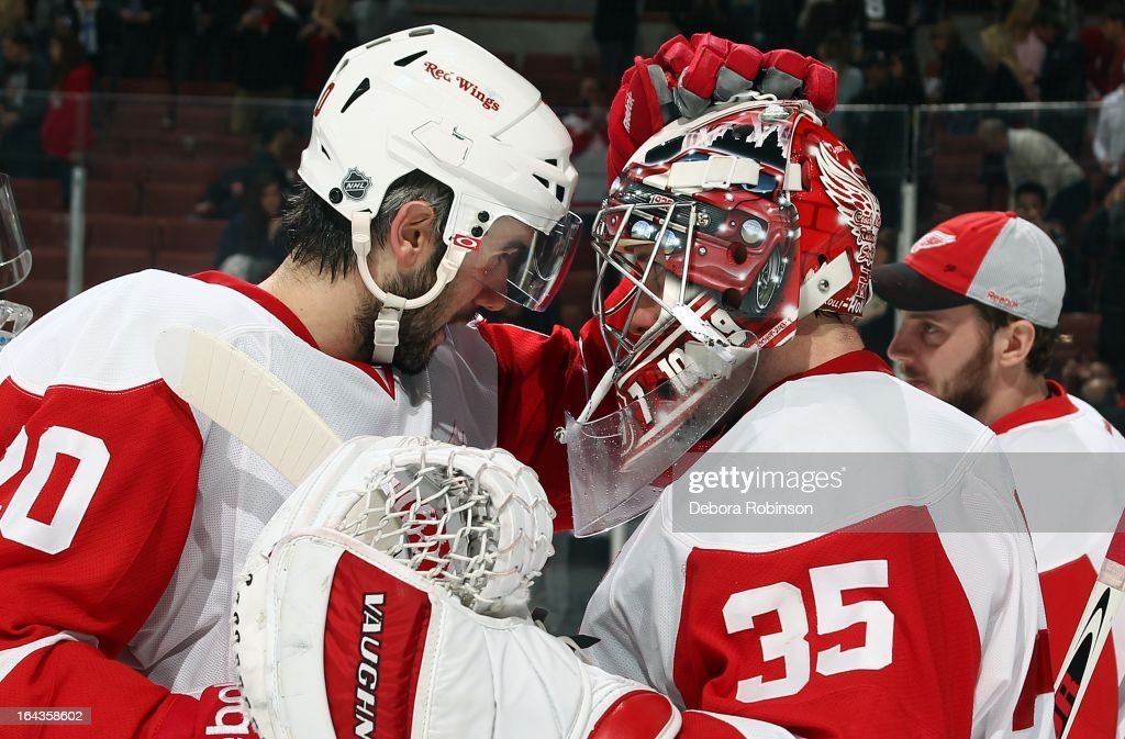 Drew Miller #20 of the Detroit Red Wings congratulates goalie Jimmy Howard #35 after the win against the Anaheim Ducks. March 22, 2013 at Honda Center in Anaheim, California.
