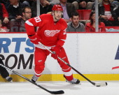 Drew Miller of the Detroit Red Wings controls the puck during an NHL game against the Tampa Bay Lightning at Joe Louis Arena on November 30 2011 in...