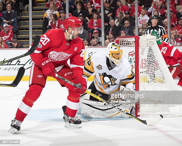 Drew Miller of the Detroit Red Wings looks for a pass in front of goaltender MarcAndre Fleury of the Pittsburgh Penguins during an NHL game at Joe...