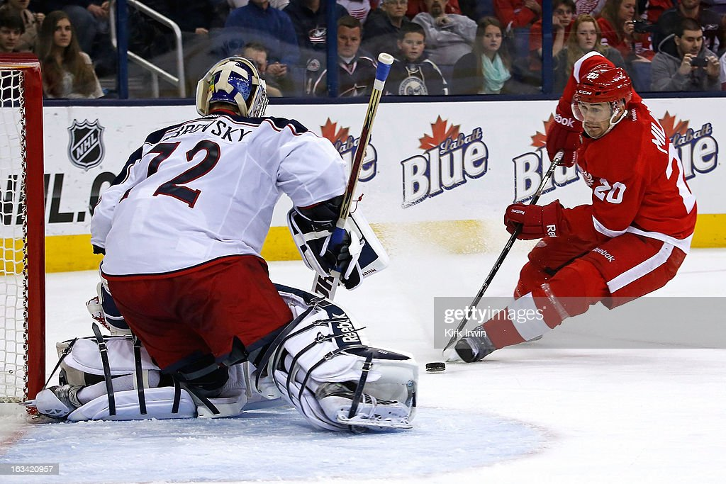 Drew Miller #20 of the Detroit Red Wings mishandles the puck and sends a shot wide of <a gi-track='captionPersonalityLinkClicked' href=/galleries/search?phrase=Sergei+Bobrovsky&family=editorial&specificpeople=4488556 ng-click='$event.stopPropagation()'>Sergei Bobrovsky</a> #72 of the Columbus Blue Jackets during the third period on March 9, 2013 at Nationwide Arena in Columbus, Ohio. Columbus defeated Detroit 3-0.