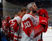 Drew Miller of the Detroit Red Wings stands for the anthems before playing against the Buffalo Sabres on November 24 2013 at the First Niagara Center...