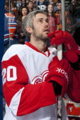 Drew Miller of the Detroit Red Wings stands for the national anthems before a game against the Edmonton Oilers at Rexall Place on February 4 2012 in...
