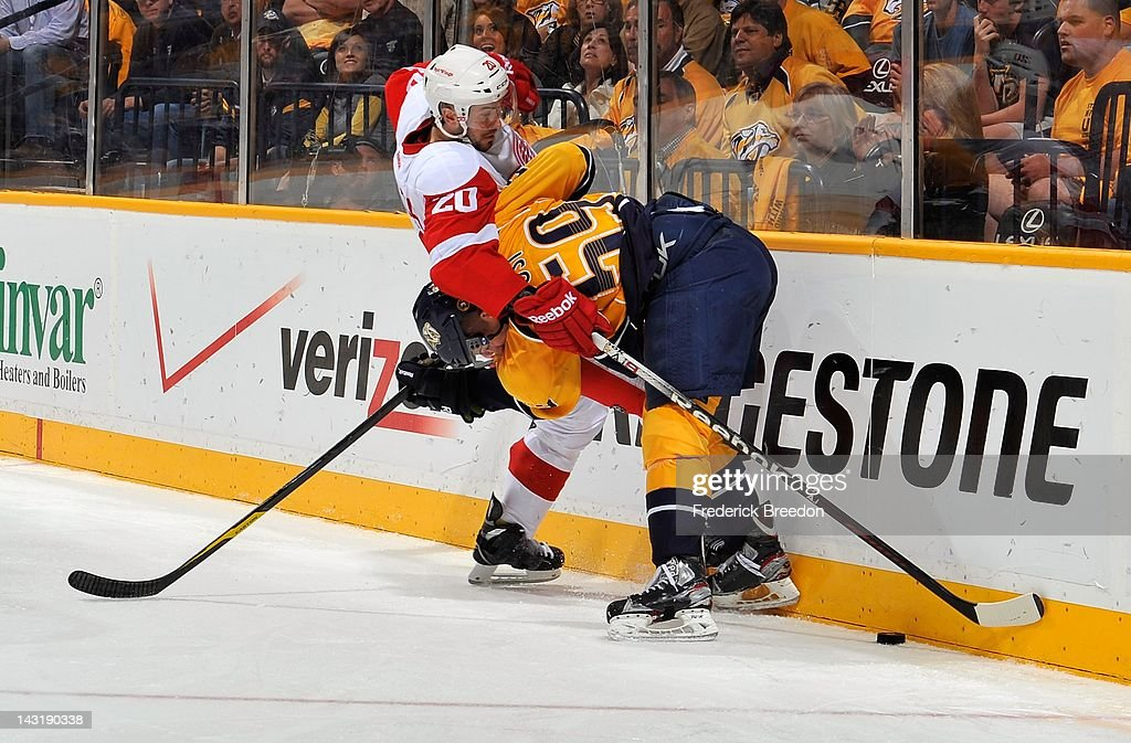 Drew Miller #20 of the Detroit Red Wings ties up <a gi-track='captionPersonalityLinkClicked' href=/galleries/search?phrase=Roman+Josi&family=editorial&specificpeople=4247871 ng-click='$event.stopPropagation()'>Roman Josi</a> #59 of the Nashville Predators in Game Five of the Western Conference Quarterfinals during the 2012 NHL Stanley Cup Playoffs at the Bridgestone Arena on April 20, 2012 in Nashville, Tennessee.