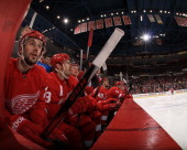 Drew Miller of the Detroit Red Wings watches the action from the bench during an NHL game at Joe Louis Arena on April 11 2013 in Detroit Michigan San...