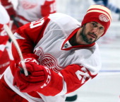 Drew Miller of the Detroit Red Wings wearing a Winter classic toque shoots during warmup before NHL action at the Air Canada Centre December 21 2013...