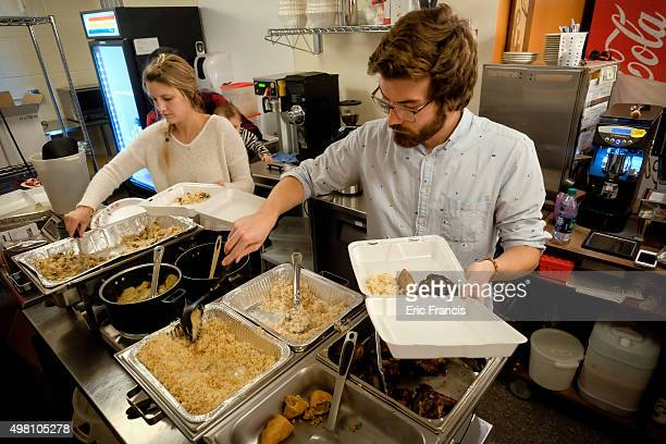 Drew Miller prepares meals as members of the local and immigrant community gather for a fundraiser at Cultiva Labs on November 20 2015 in Lincoln...