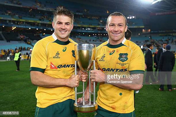Drew Mitchell and Matt Giteau of the Wallabies pose with the Rugby Championship trophy after winning the Rugby Championship match between the...