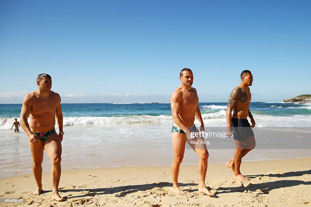 Drew Mitchell, Matt Giteau and Israel Folau of the Wallabies walk from the water during an Australian Wallabies recovery session at Coogee Beach on August 9, 2015 in Sydney, Australia.