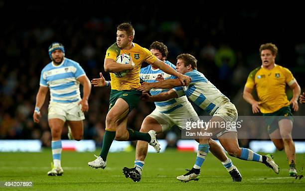 Drew Mitchell of Australia breaks the challenge of Julian Montoya and Santiago Cordero of Argentina on the way to setting up Adam AshleyCooper to...