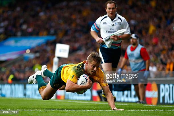 Drew Mitchell of Australia scores his teams second try during the 2015 Rugby World Cup Quarter Final match between Australia and Scotland at...