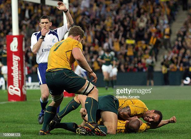 Drew Mitchell of the Wallabies celebrates after scoring a try during the 2010 TriNations match between the Australian Wallabies and the South African...