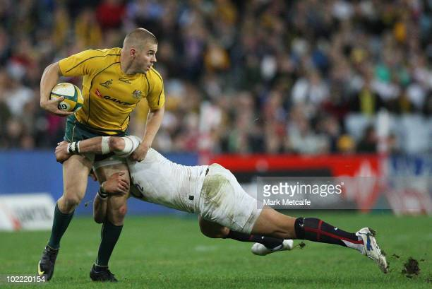 Drew Mitchell of the Wallabies is tackled during the Cook Cup Test Match between the Australian Wallabies and England at ANZ Stadium on June 19 2010...