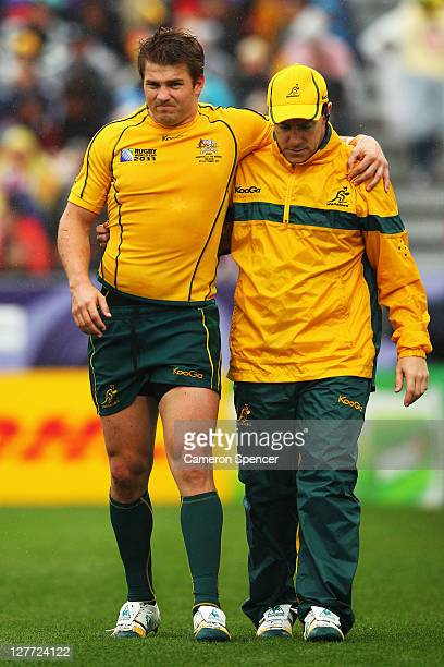 Drew Mitchell of the Wallabies leaves the pitch injured during the IRB 2011 Rugby World Cup Pool C match between Australia and Russia at Trafalgar...