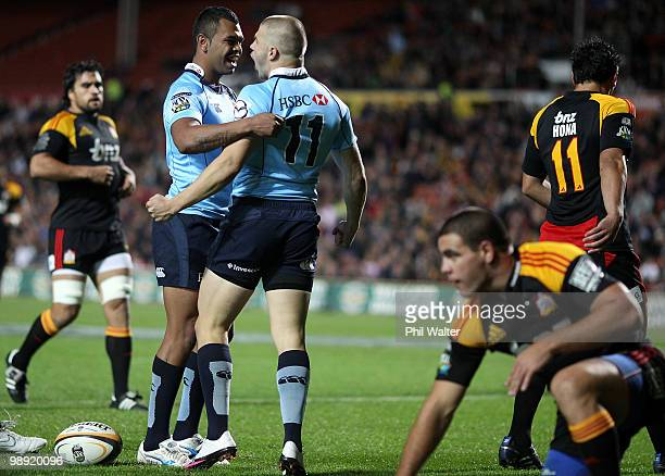 Drew Mitchell of the Waratahs celebrates his try with Kurtley Beale during the round 13 Super 14 match between the Chiefs and the Waratahs at Waikato...