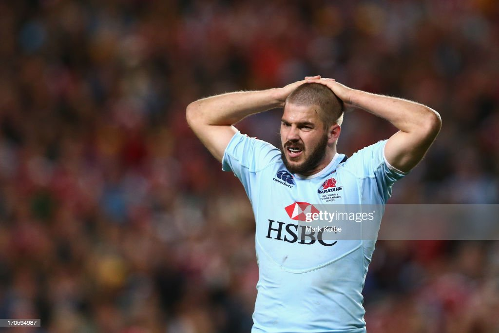 Drew Mitchell of the Waratahs grimaces during the match between the NSW Waratahs and the British & Irish Lions at Allianz Stadium on June 15, 2013 in Sydney, Australia.