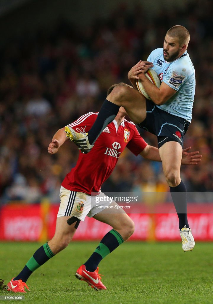<a gi-track='captionPersonalityLinkClicked' href=/galleries/search?phrase=Drew+Mitchell&family=editorial&specificpeople=215065 ng-click='$event.stopPropagation()'>Drew Mitchell</a> of the Waratahs is tackled during the match between the Waratahs and the British & Irish Lions at Allianz Stadium on June 15, 2013 in Sydney, Australia.