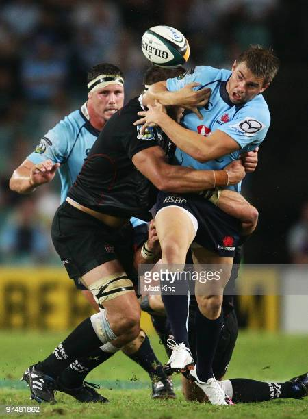 Drew Mitchell of the Waratahs loses the ball in a tackle during the round four Super 14 match between the Waratahs and the Blues at Sydney Football...