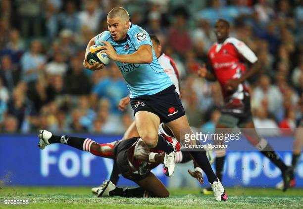 Drew Mitchell of the Waratahs makes a break during the round five Super 14 match between the Waratahs and the Lions the at Sydney Football Stadium on...
