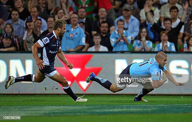 Drew Mitchell of the Waratahs scores a try during the round one Super Rugby match between the Melbourne Rebels and the Waratahs at AAMI Park on...
