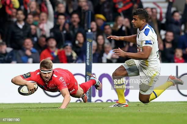 Drew Mitchell of Toulon dies past Wesley Fofana of Clermont to score his team's second try during the European Rugby Champions Cup Final match...