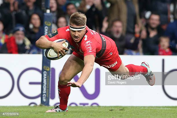 Drew Mitchell of Toulon dives over to score his team's second try during the European Rugby Champions Cup Final match between ASM Clermont Auvergne...