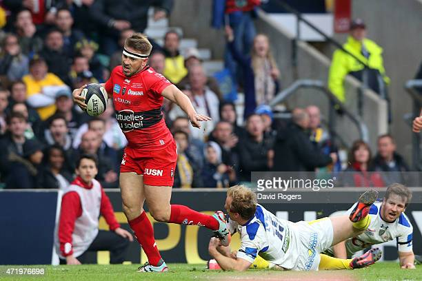 Drew Mitchell of Toulon evades the tackle form Nick Abendanon of Clermont en route to scoring his team's second try during the European Rugby...